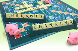 Scrabble board showing text 'the law is changing'